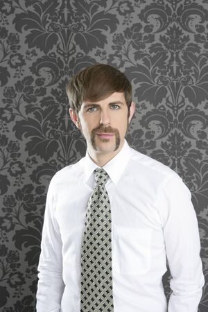 seductive expression: businessman retro mustache over gray wallpaper tie and shirt