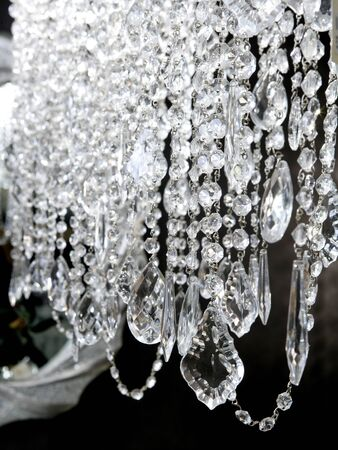crystal strass lamp white over black background luxury interior design photo