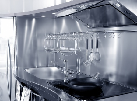 black appliances: Kitchen silver sink and vitroceramic stove hob modern decoration Stock Photo