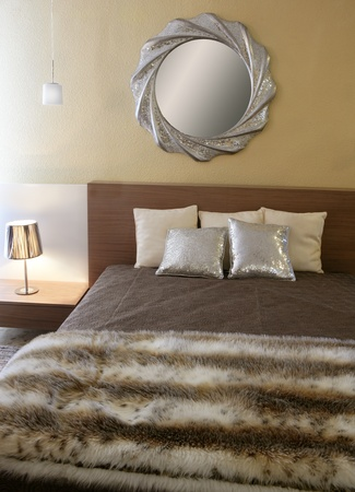 bedroom modern silver mirror fake fur african blanket Stock Photo - 8425050
