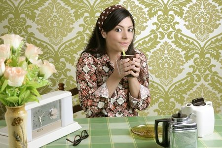 Retro woman drinking coffee on kitchen vintage wallpaper photo