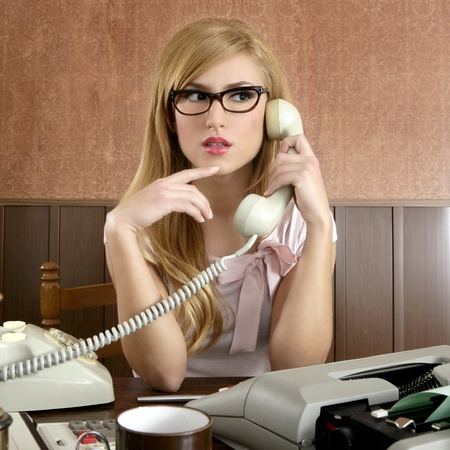 beautiful retro businesswoman vintage secretary wooden office and glasses talking telephone photo