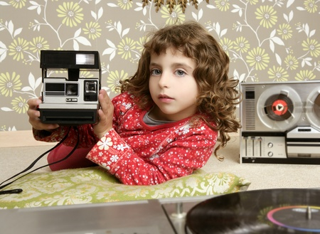 camera retro photo little girl in vintage room wallpaper Stock Photo - 8621665