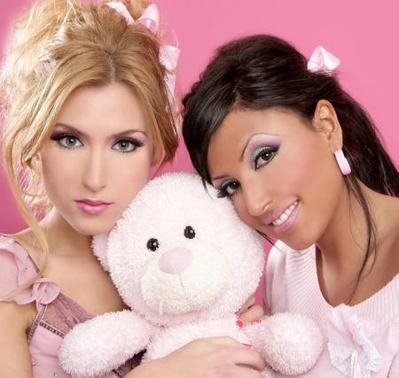 blonde and brunette girls hug a pink teddy bear tender gesture barbie style Stock Photo - 8621677
