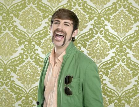 eccentric: eccentric retro mustache geek man salesperson sixties seventies Stock Photo