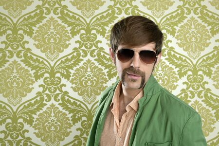 salesperson: geek retro salesperson man funny mustache sunglasses in green wallpaper Stock Photo