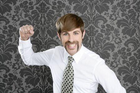 aggressive funny retro mustache businessman on vintage wallpaper photo
