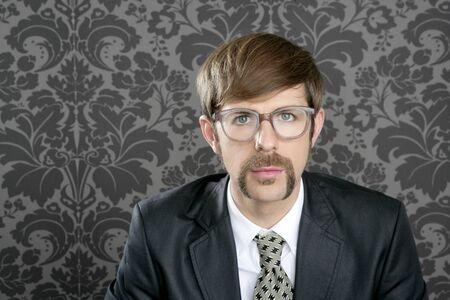 accountants: businessman nerd retro glasses geek portrait on vintage wallpaper