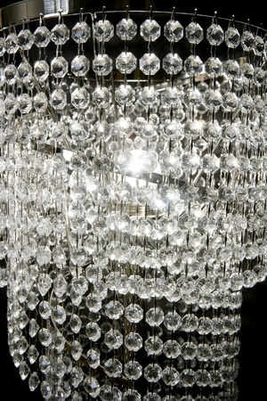 chandelier background: crystal strass lamp white over black background luxury interior design