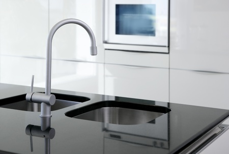 kitchen faucet and oven modern black and white inter design Stock Photo - 8621622