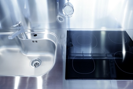 Kitchen silver sink and vitroceramic stove hob modern decoration Stock Photo - 8621619