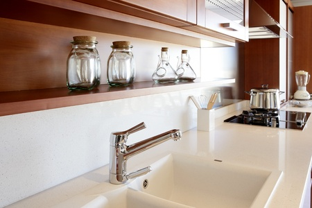 kitchen bench: red wood kitchen white kitchen bench modern interior decoration Stock Photo