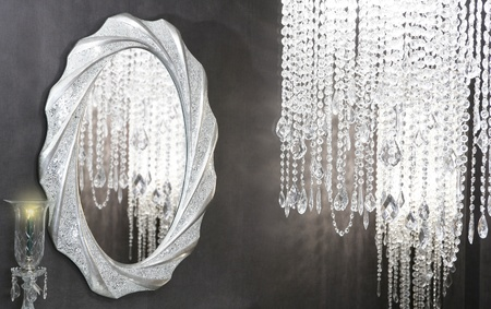strass: Crystal strass lamp oval mirror modern decoration on black wall Stock Photo