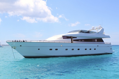 beaches of spain: luxury yacht in turquoise Illetes Formentera mediterranean sea Balearic Islands
