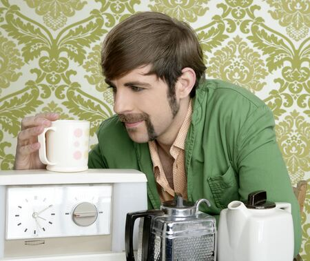 geek retro man drinking tea coffee vintage teapot in wallpaper photo