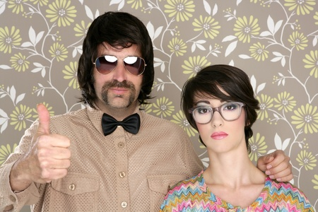 nerd girl: nerd silly couple tacky retro 60s man woman ok hand sign floral wallpaper