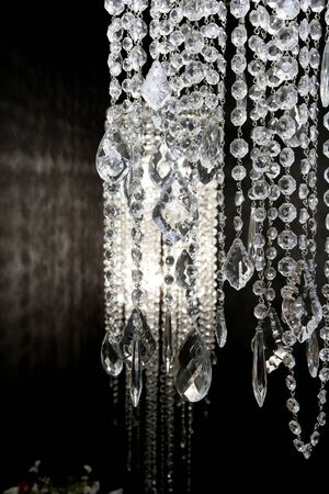 circle design: crystal strass lamp white over black background luxury interior design