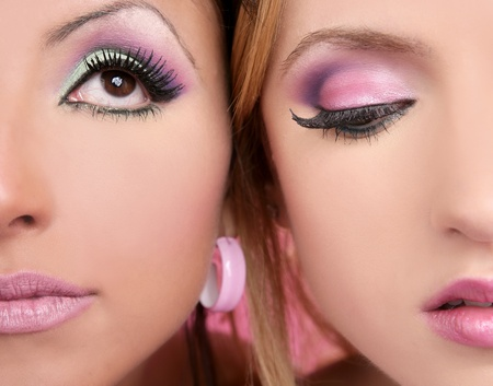 makeup closeup detail macro two faces multiracial pink eyeshadow and lipstick photo
