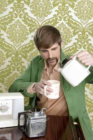 geek retro man drinking tea coffee vintage teapot in wallpaper photo