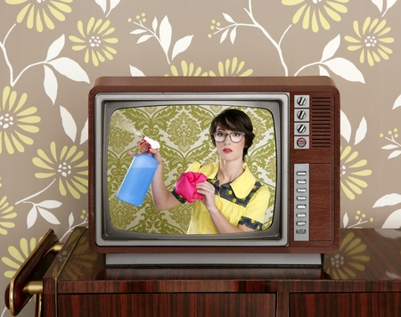 ad: ad tv commercial retro nerd housewife cleaning chores wood television Stock Photo