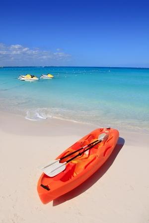 Kayak in beach sand caribbean sea turquoise water photo