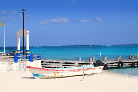 morelos: Puerto Morelos beach with boat in turquoise Caribbean Stock Photo