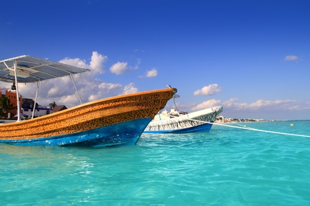 morelos: Puerto Morelos beach with  boats in turquoise caribbean beach Stock Photo