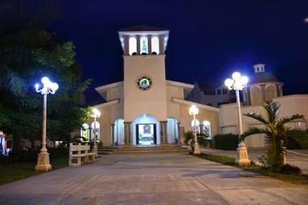 morelos: Puerto Morelos night church in  Mayan Riviera Stock Photo