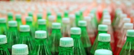 colorful juice beverage plastic bottle in factory line photo