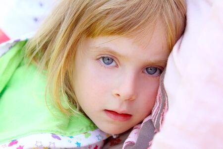 girl lying on pillow beautiful blue eyes toddler looking camera Stock Photo - 8926794