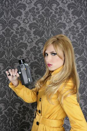 fashion Super 8mm camera reporter woman vintage wallpaper yellow coat Stock Photo - 8927000
