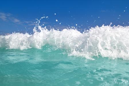 beautiful blue turquoise wave caribbean sea water foam photo