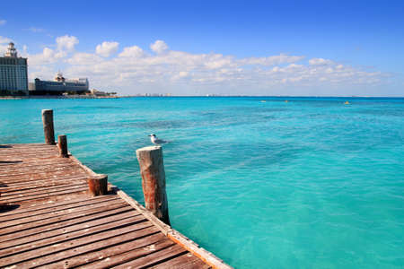 Cancun wood pier in  tropical Caribbean sea photo
