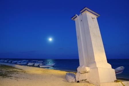 morelos: lighthouse Puerto Morelos with night moon sea