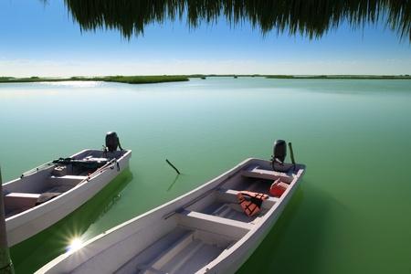 mangrove: boats in pier mangrove lagoon in Mayan Riviera sian kaan