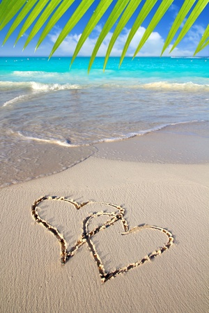 hearts in love written in Caribbean beach sand tropical aqua sea Stock Photo - 9030958