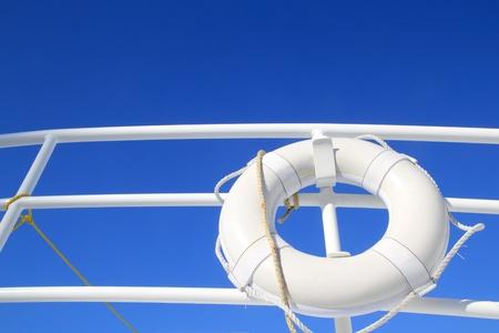 impiccata: boat buoy white hanged in railing summer vacation blue sky Archivio Fotografico