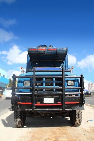 aged grunge old truck under sunny blue sky