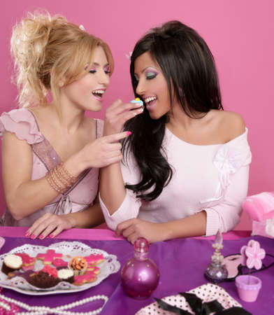 barbie fashion girls fighting for eat the sweet pink background photo