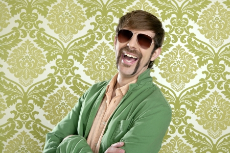 jokes: geek retro salesperson man funny mustache sunglasses in green wallpaper Stock Photo