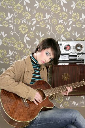 tape recorder: retro woman musician guitar player vintage wallpaper Stock Photo