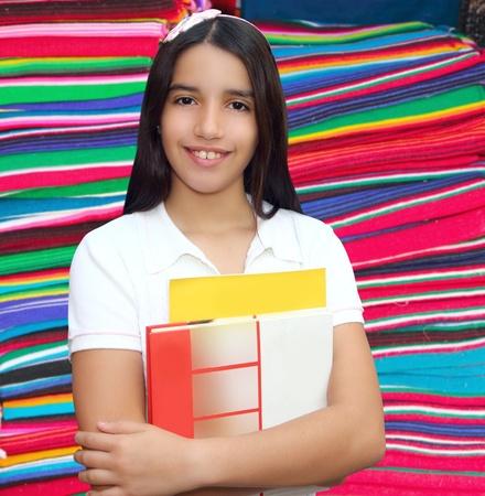Brunette student young girl teen latin holding books serape mayan background photo