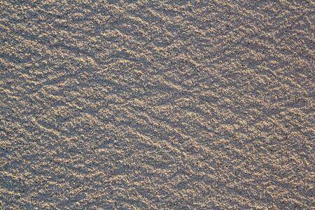beach white sand macro texture pattern in caribbean shore photo