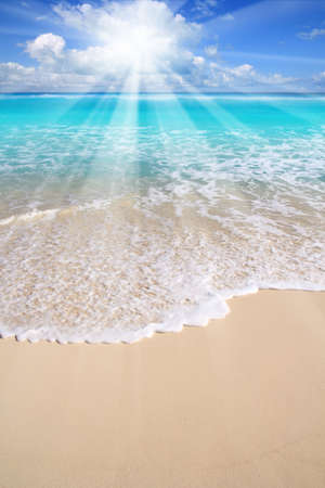 Caribbean turquoise beach sea sun beams from clouds photo