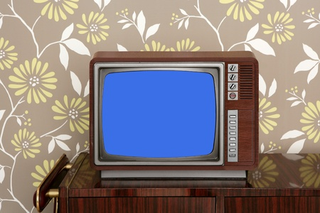 retro wooden tv on wooden vitage 60s furniture floral wallpaper photo