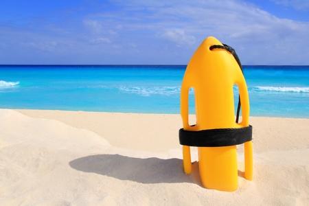 baywatch: Baywatch rescue buoy yellow on tropical beach Caribbean sea