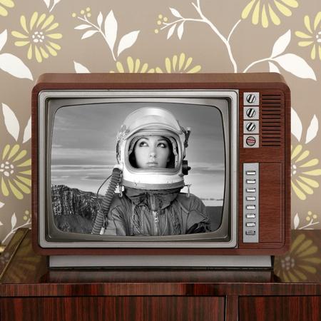retro revival: space odyssey mars astronaut on retro 60s tv moon discovery metaphor Stock Photo