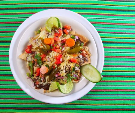 totopos: Nachos totopos prepared with cheese vegetables chili Mexican food style