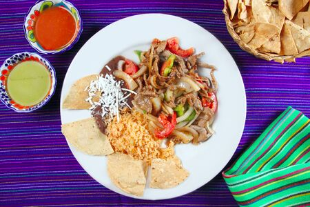 totopos: Fajitas de res beef fajita Mexican food nachos and chili sauce Stock Photo