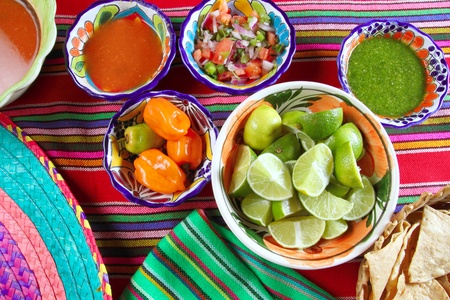 chips and salsa: Mexican food varied chili sauces nachos lemon Mexico flavor Stock Photo